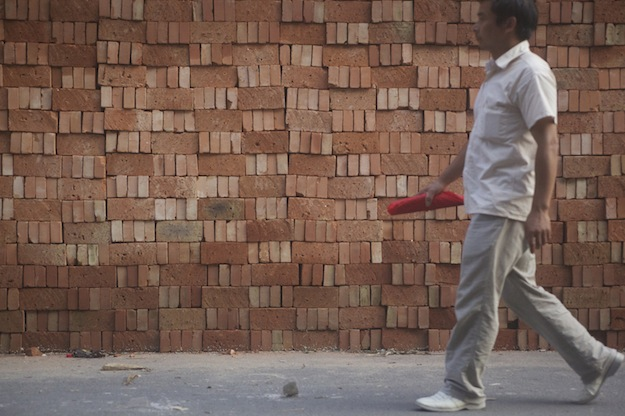 man and bricks
